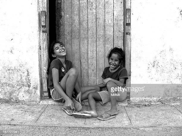 two joyful sisters in old havana, cuba - rotten teeth stock photos and pictures