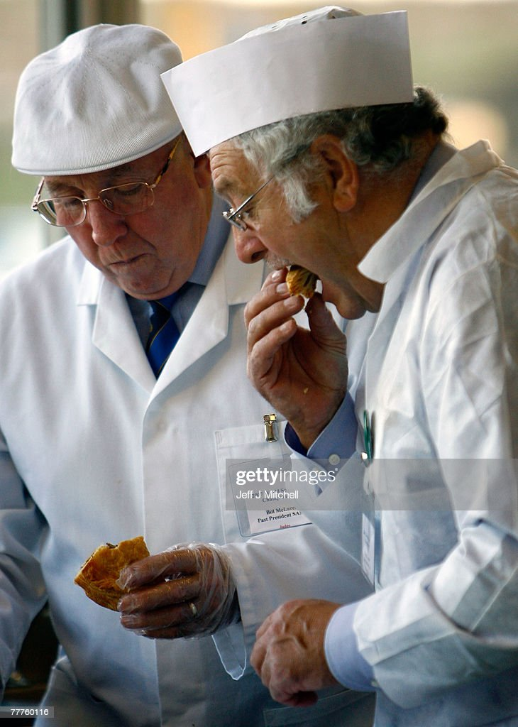 Two judges at the World Scotch Pie Championship inspects a pie during judging at Lauder College November 7, 2007 in Dunfermline, Scotland. A total of 70 bakers and butchers will vie for the coveted title of World Scotch Pie Champion.