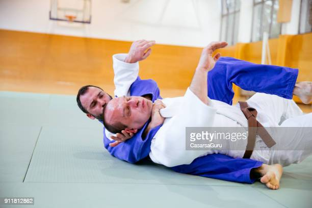 two judoist fighting - chokehold stock pictures, royalty-free photos & images