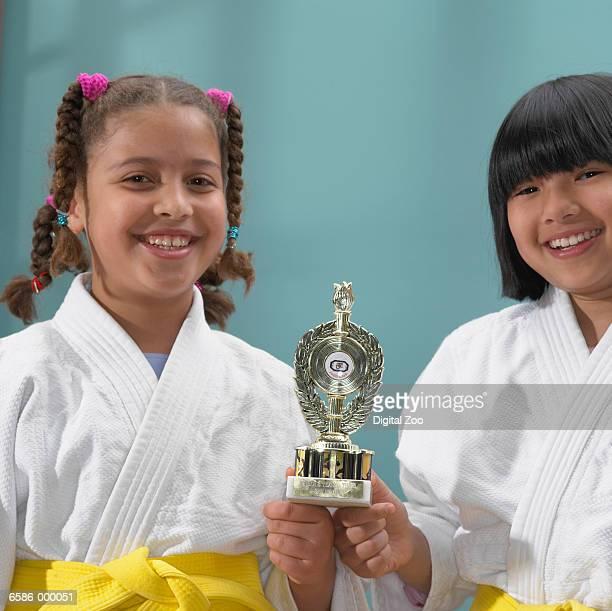 two judoists holding trophy - trophy - fotografias e filmes do acervo