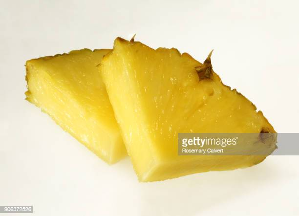 two juicy pineapple slices together in close-up on white. - pineapple stock pictures, royalty-free photos & images
