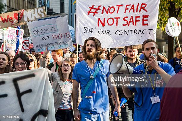 Two Junior doctors and other NHS staff demonstrate at the TUC No to Austerity demo outside the Conservative Party conference, Manchester. 4th October...