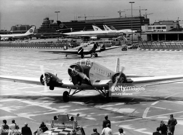 Two Junkers JU52 also called 'Tante JU' on the runway of the airport in Frankfurt on the Main on 8 July 1986 One 'Tante JU' of the Lufthansa and two...