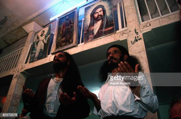 Two Kasnazani dervishes chanting during a remembrance ceremony in Sanandaj capital of the Kurdistan province of Iran 17th July 1997 Pictures of Imam...