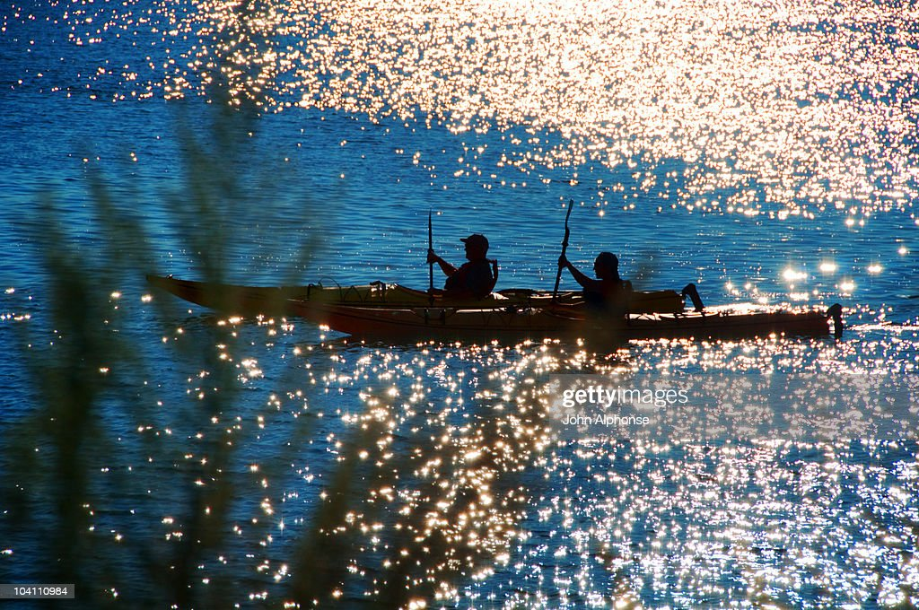 Two Kayakers in Shimmering Waters : Stock Photo