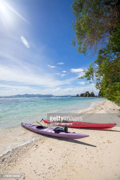 two kayaks on a beach in the philippines. - capital region stock pictures, royalty-free photos & images