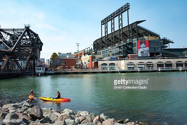 Two kaykers paddle through McCovey Cove near ATT Park the baseball stadium of the San Francisco Giants in the China Basin neighborhood of San...