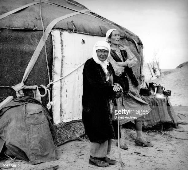 Two Kazakh women by their yurt in the Kysylkoom desert in Uzbekistan Soviet Union 1970s