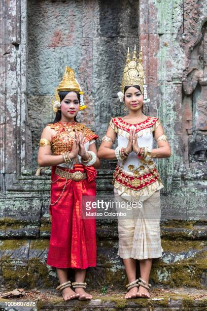 two khmer apsara dancers, angkor temples, cambodia - traditionally cambodian stock pictures, royalty-free photos & images