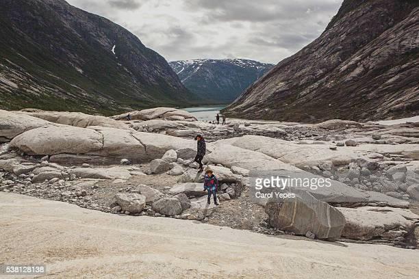 two kids approaching to Nigardsbreen glacier
