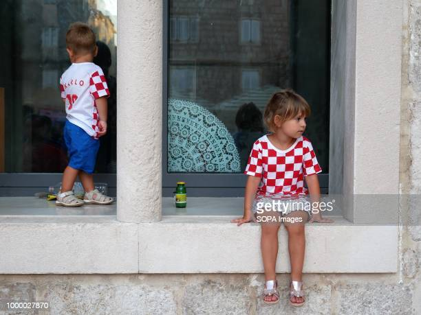 Two kids are seen putting on Croatian tshirts Croatians in the Island of Pag watched the world cup football final match Croatia vs France Croatia...