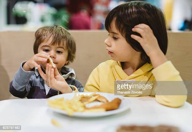 Two kids eating