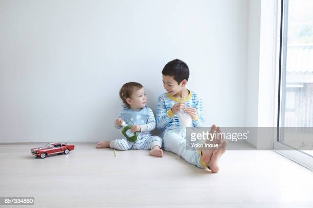 Two kids enjoying juice together