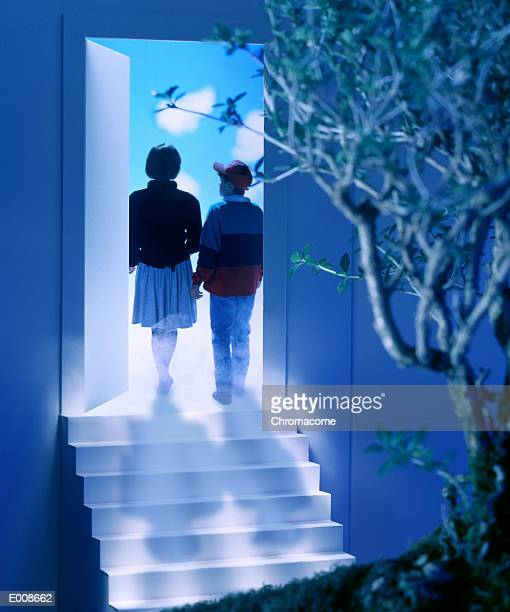 two kids entering a mysterious door - magic doors stock pictures, royalty-free photos & images