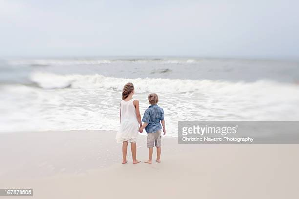 Two Kids holding hands on the beach