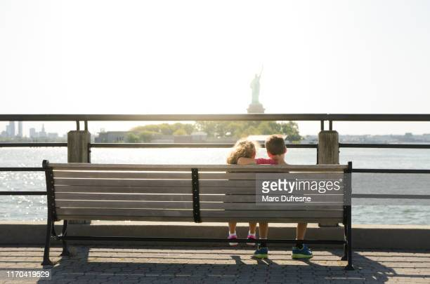 two kids looking at statue of liberty - jersey city stock pictures, royalty-free photos & images