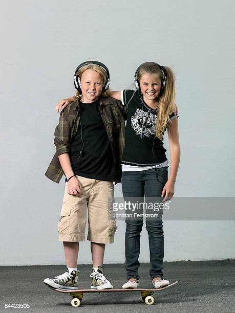 Two kids on a skateboard