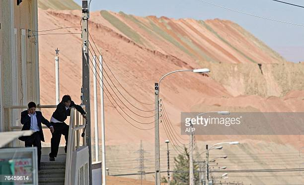 Two kids play in the outskirts of the mining village of Chuquicamata near to the city of Calama600km north of Santiago 01 September 2007 Chuquicamata...