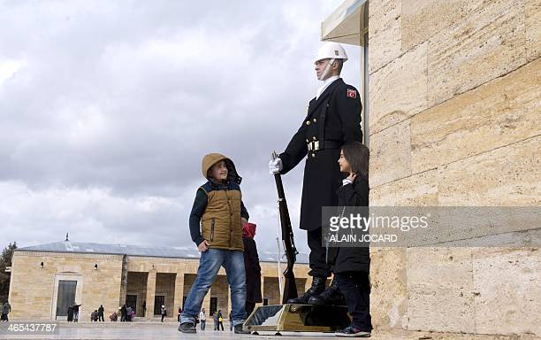 Two kids play next to an honour guard at the mausoleum of Mustafa Kemal Ataturk in Ankara on January 27 2014 AFP PHOTO/ ALAIN JOCARD