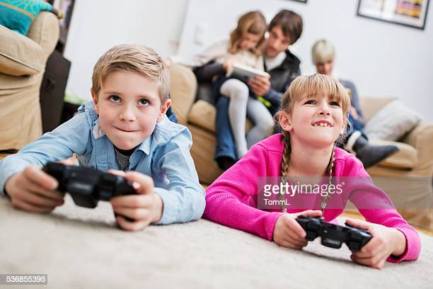 Two Kids Playing Game Console