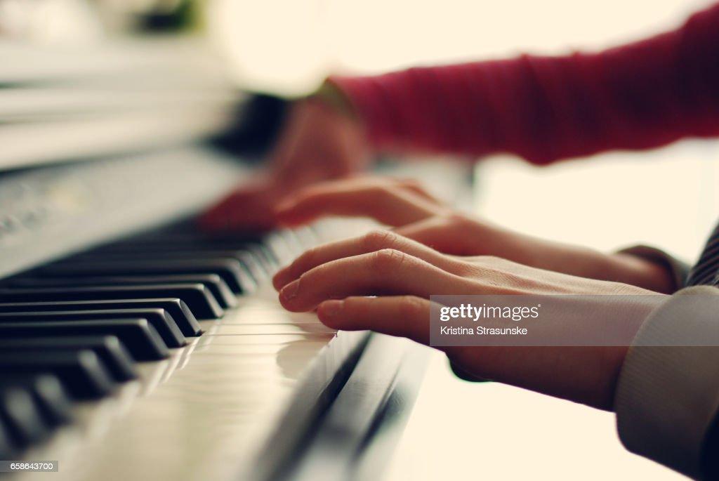 Two kids playing piano : Stock Photo