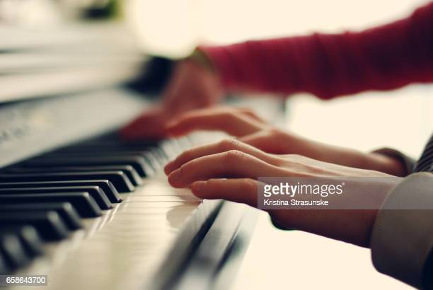 two kids playing piano - keyboard player stock photos and pictures