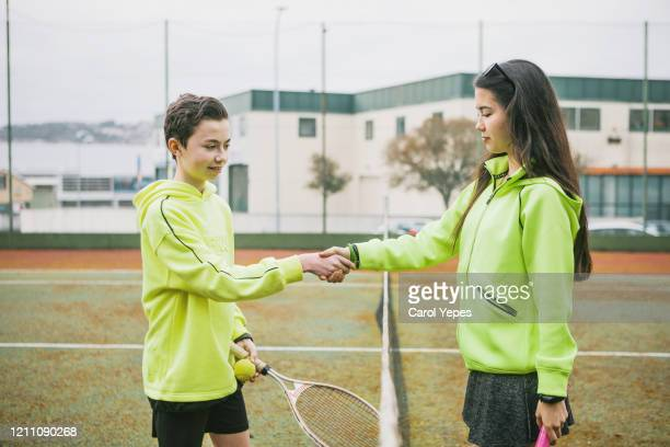 two kids shaking hands after tennis classes - tennis tournament stock pictures, royalty-free photos & images