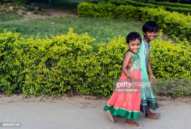 two kids walking and smiling, india - tamil nadu stock pictures, royalty-free photos & images