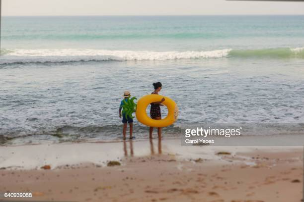 two kids walking in the sea shore