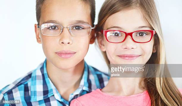 Two kids with eyeglasses.