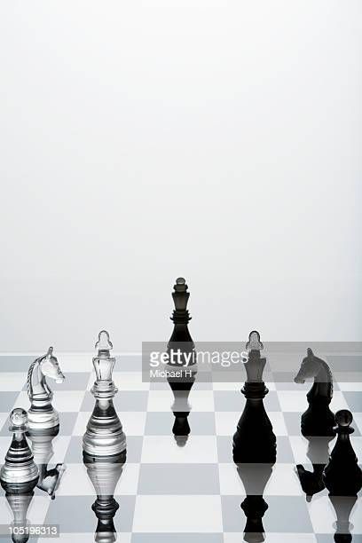 Two kinds of chess pieces put by chess board