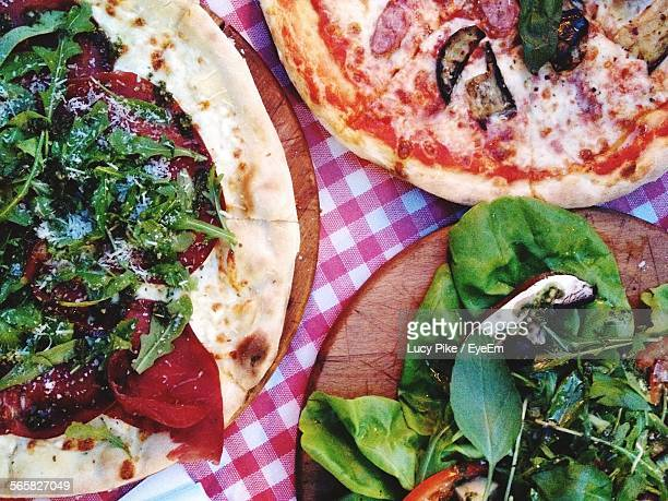 Two Kinds Of Pizza And Salad