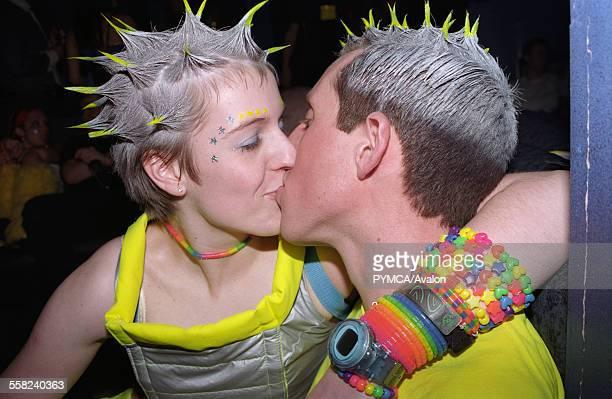 Two kissing clubbers Passion Emporium Milton Keynes UK 2002