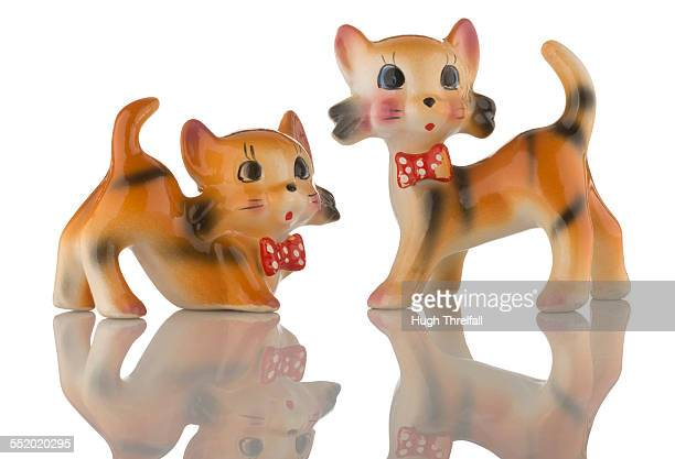 Two kitsch china playful cat figurines