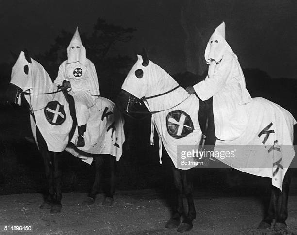 Two Klu Klux Klansmen on horseback