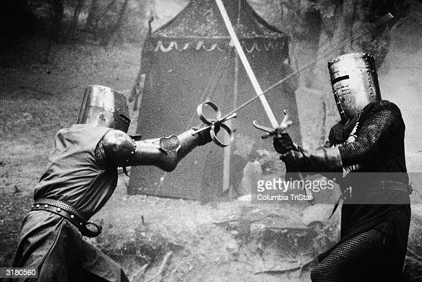 Two knights in metal masks duel in a scene from the medieval comedy 'Monty Python and The Holy Grail' directed by Terry Gilliam and Terry Jones 1975
