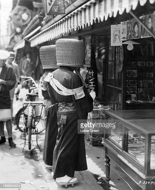 Two komuso monks with straw bascinets or hoods over their heads Japan 1955