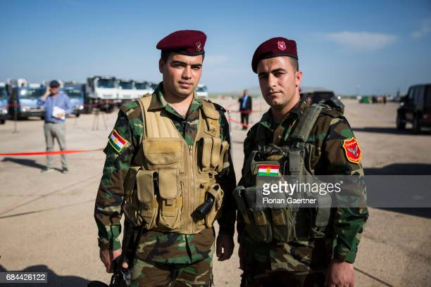 Two Kurdish soldiers posing in front of the camera on April 20 2017 in Bashiqa Iraq