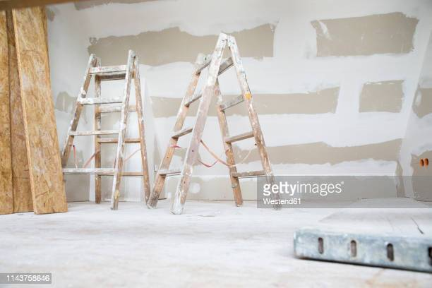 two ladders in an attic to be renovated - rebuilding stock pictures, royalty-free photos & images