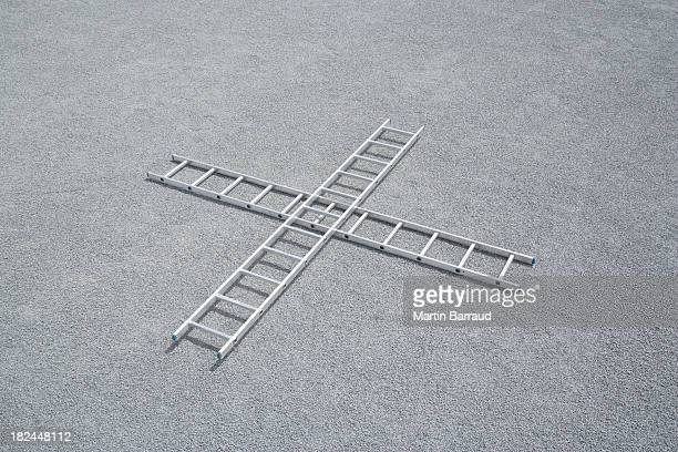 Two ladders on ground outdoors