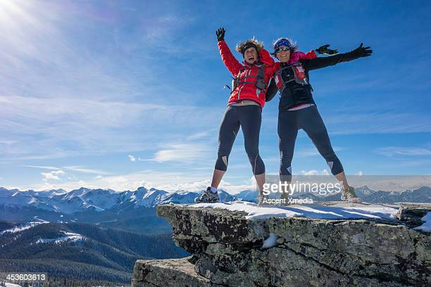Two ladies celebrate success together on mt summit