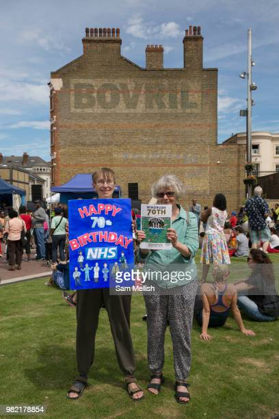 Two ladies celebrate the 70th anniversary of the NHS at Windrush Square during the 70th anniversary of the Empire Windrush arriving in England on the...