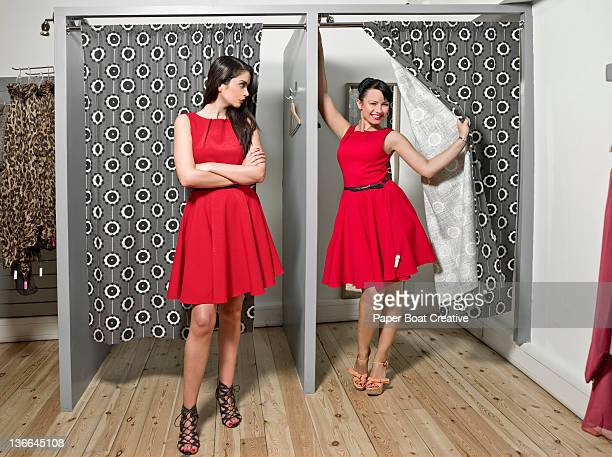 two ladies coming out with the same red dress - repetition stock pictures, royalty-free photos & images
