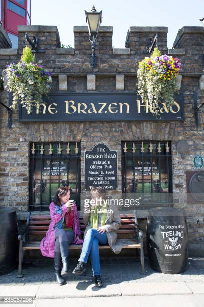 Two ladies drink Guinness at The Brazen Head in Merchants Quay on 07th April 2017 in Dublin Republic of Ireland The Brazen Head pub dates back to...