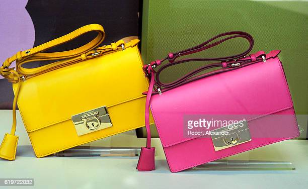 August 27, 2016: Two ladies' handbags are featured in a window display at the Salvatore Ferragamo store on Fifth Avenue in New York City.