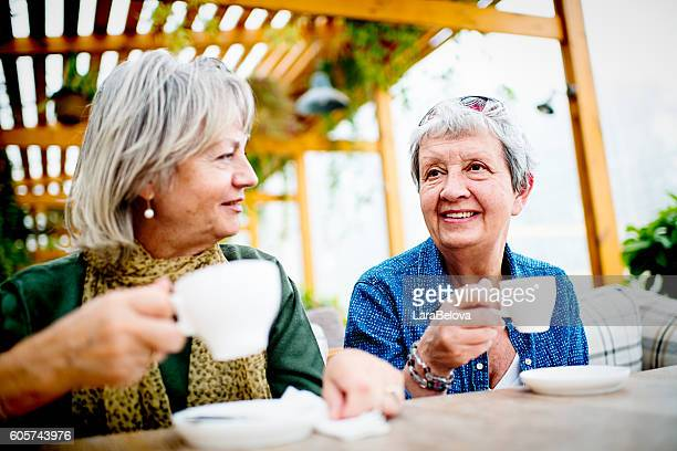 Two ladies in sidewalk cafe