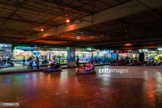 Two ladies on the Clash Machines attraction, on the first day of the Luna Park opening in Molfetta on 4 September 2021. On the occasion of the...