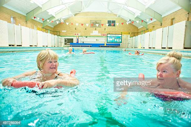 two ladies relaxing at water aerobics