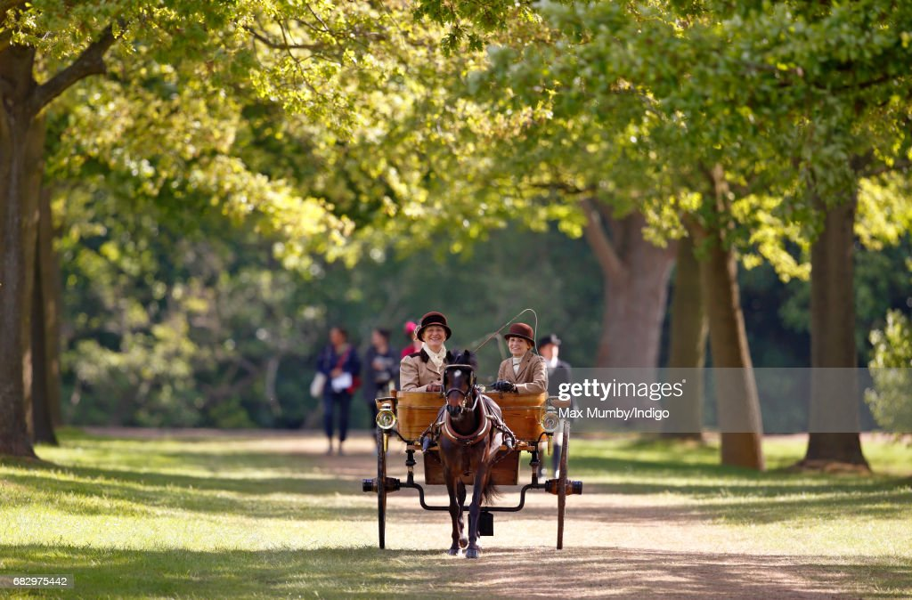 Two ladies seen carriage driving as they head to the start of The Champagne Laurent-Perrier Meet of the British Driving Society on day 5 of the Royal Windsor Horse Show in Home Park on May 14, 2017 in Windsor, England. Lady Louise has taken over from her Grandfather Prince Philip, Duke of Edinburgh to lead the procession, driving a recently restored carriage used by Queen Elizabeth II in 1943 and being drawn by one of The Queen's Fell Ponies.