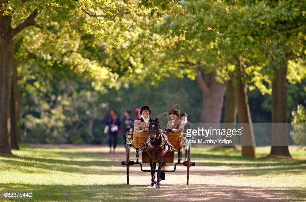 Two ladies seen carriage driving as they head to the start of The Champagne LaurentPerrier Meet of the British Driving Society on day 5 of the Royal...